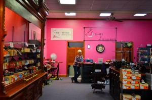 Marge Hoffman waits for customers to enter Divine Shoes and Accessories during their last week of business on Wednesday, Sept. 30, 2015 in Fulton, Missouri. Even though she's retired, Hoffman accepted a part-time job in the shoe store because she loved her employers.